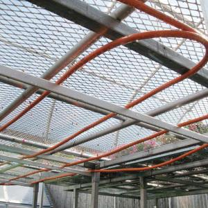 Radiant coils under greenhouse benches