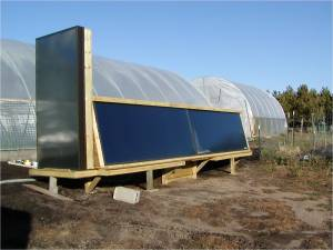 High tunnel soil heated with solar power