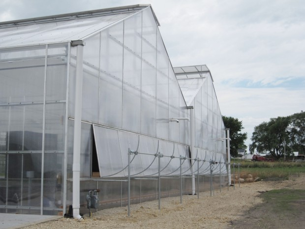 Greenhouse equipped with Gutter System, Power Vent Systems and Custom Vents using Aluminum Extrusions.